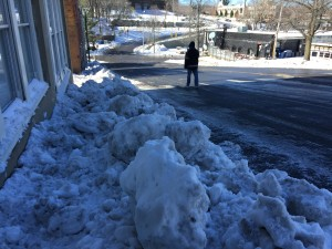 Is it fair to threaten property owners with a fine after public agency plows deposited snow boulders on their sidewalks?